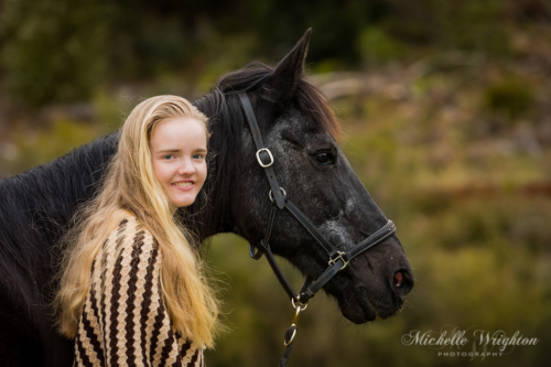 Lifestyle photograph of horse and rider